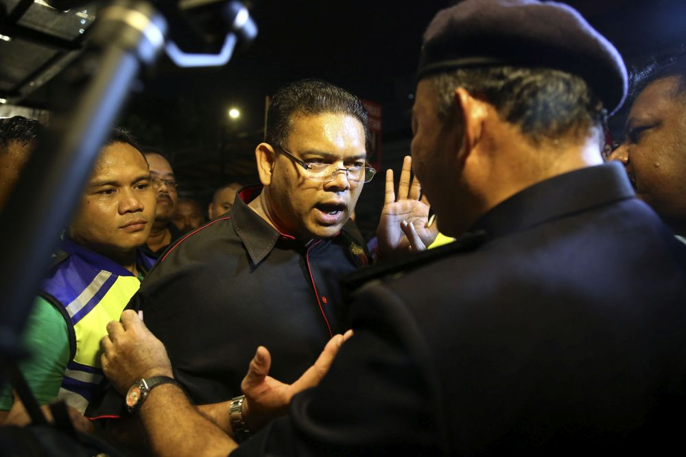 A rally organised by Datuk Lokman Noor Adam outside Sogo turned chaotic when the group tried to march to the Dang Wangi district police station. — Picture by Yusof Mat Isa