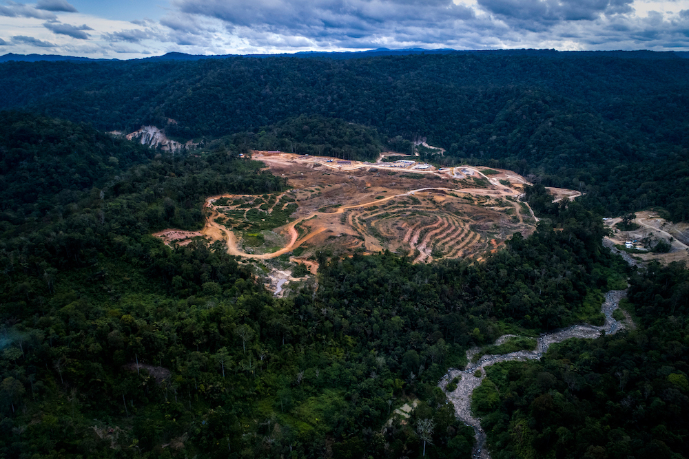 This handout picture from the Sumatran Orangutan Conservation Programme (SOCP) taken on August 20, 2018 shows an aerial view of land cleared as a staging area for the building of a new hydroelectric dam in the Batang Toru rainforest on Sumatra island. — AFP pic