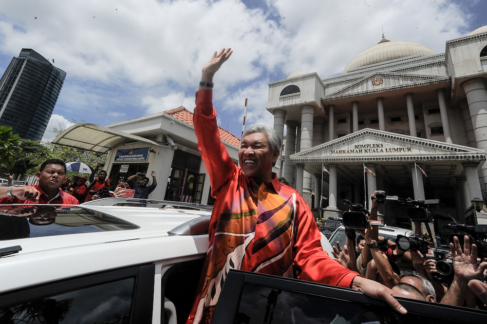 Umno president, Datuk Seri Zahid Hamidi waves as he leaves the Kuala Lumpur High Court Complex after his court hearing, October 19, 2018. — Picture by Shafwan Zaidon