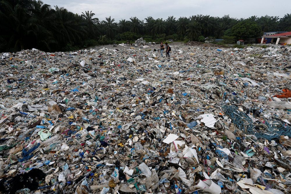 Plastic waste is piled outside an illegal recycling factory in Jenjarom, Kuala Langat October 14, 2018. — Reuters pic