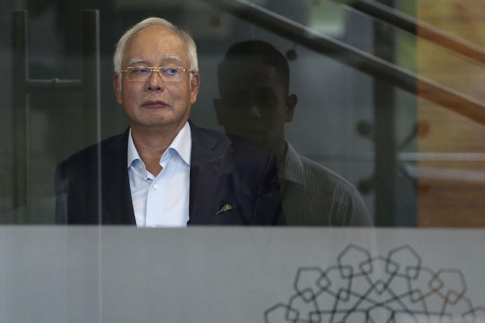 Datuk Seri Najib Razak leaves MACC headquarters in Putrajaya October 24, 2018. — Picture by Yusof Mat Isa