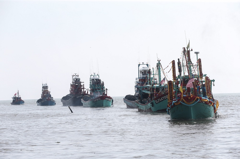 A flotilla of 89 boats set sail from Sekinchan to Sungai Besar in a ceremony held as an offering to the Chinese goddess Mazu.