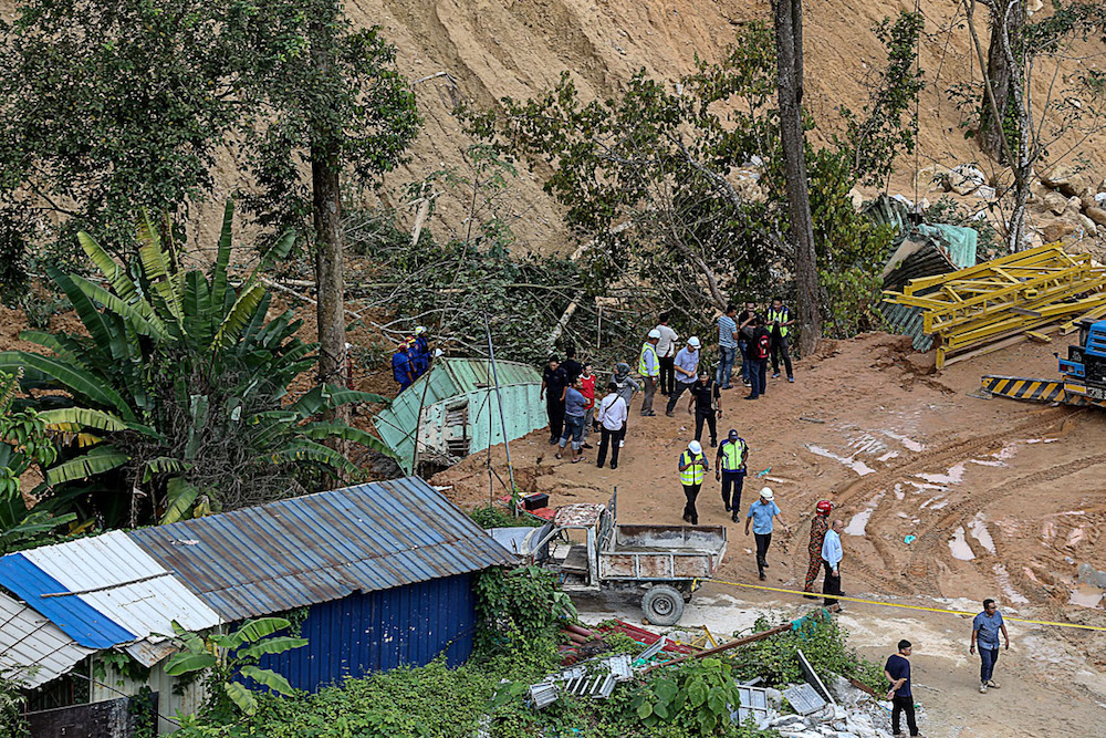 The landslide tragedy claimed the lives of nine foreign workers and three were injured. The landslide occurred at 1.56pm last Friday. — Picture by Sayuti Zainudin