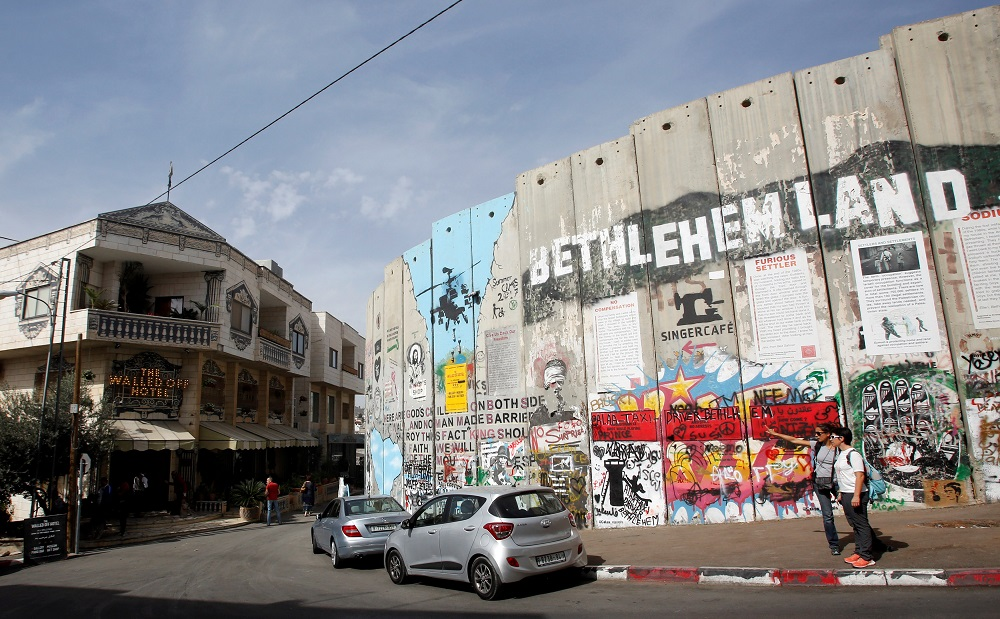 A view shows Banksy's the Walled Off hotel and a section of the Israeli barrier in Bethlehem, in the occupied West Bank October 23, 2018. — Reuters pic