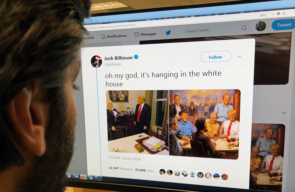 An editor looks at the Twitter feed of Josh Billinson showing a painting by Andy Thomas entilted 'The Republican Club',Los Angeles, California, on October 15, 2018. — AFP pic