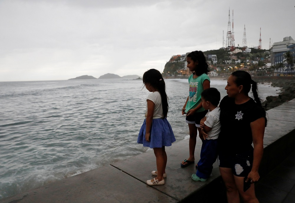 A family look at the sea along the Mazatlan boardwalk as Hurricane Willa approaches the Pacific beach resort, Mexico October 23, 2018. — Reuters pic