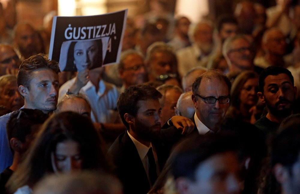 Peter Caruana Galizia and his son Matthew attend a vigil and protest on the first anniversary of the assassination of their wife and mother, anti-corruption journalist Daphne Caruana Galizia, in a car bomb, in Valletta, Malta October 16, 2018