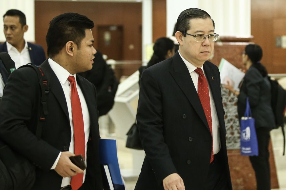 Finance Minister Lim Guan Eng (right) arrives at Parliament in Kuala Lumpur October 22, 2018. ― Picture by Hari Anggara