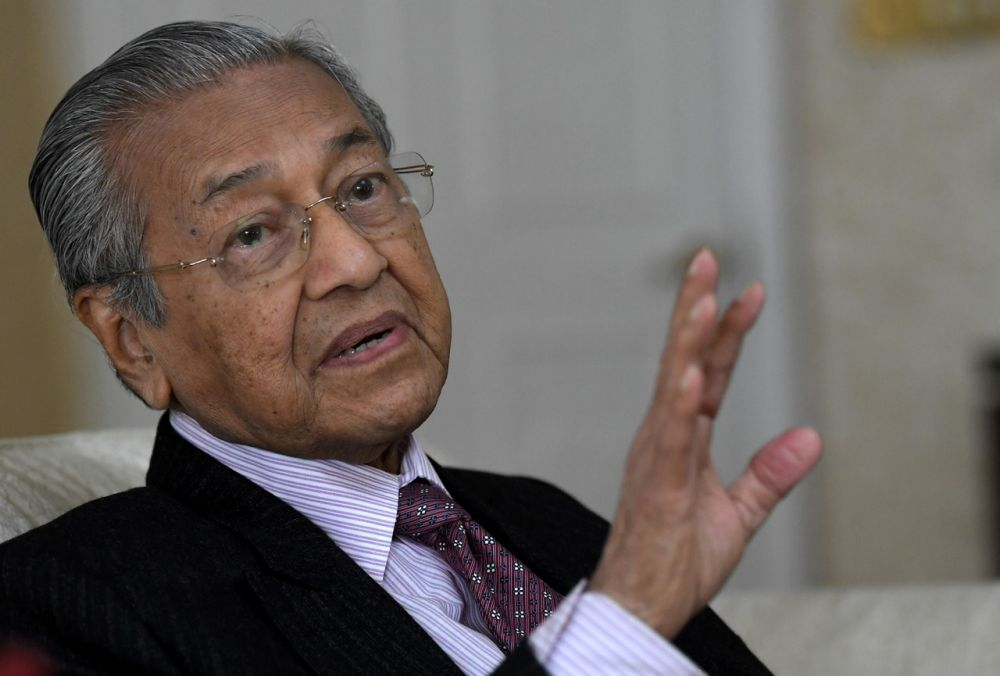Tun Dr Mahathir Mohamad said Malaysia does not need Singapore's consent to construct a crooked bridge linking both countries. ― Bernama pic