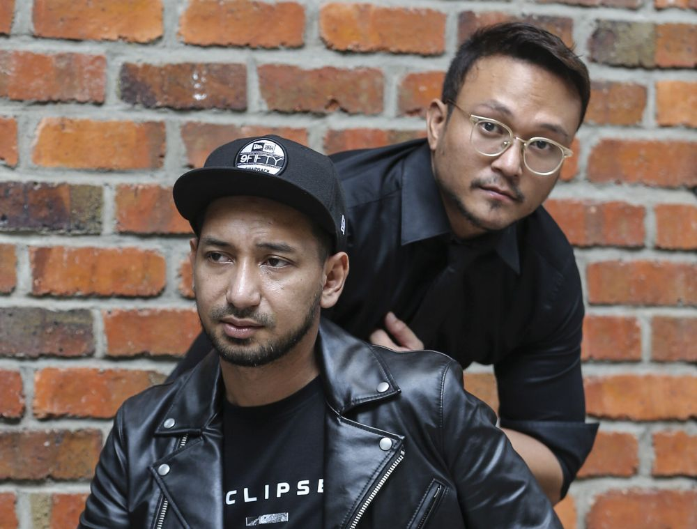 'Polis Evo 2' actors Zizan Razak (left) and Shaheizy Sam attend the film's launch at The Gasket Alley in Petaling Jaya October 12, 2018.  — Picture by Azneal Ishak