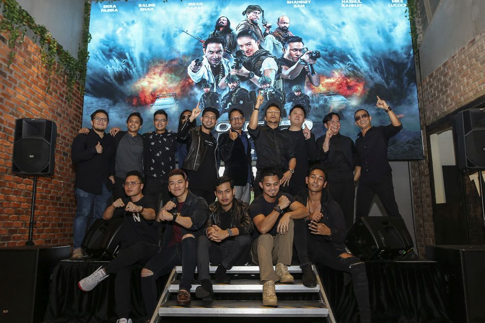 The cast of 'Polis Evo 2' pose for a group photo during the film's launch at The Gasket Alley in Petaling Jaya October 12, 2018.  — Picture by Azneal Ishak