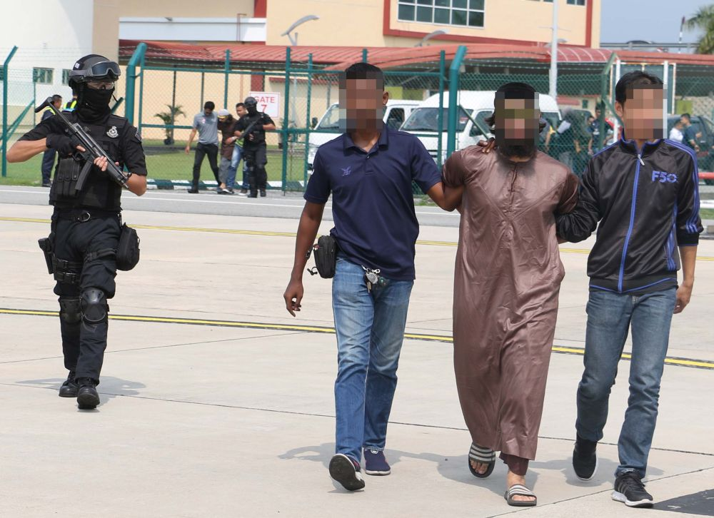 Police have arrested seven foreigners and one Malaysian for terrorism-related offences. — Picture courtesy of PDRM