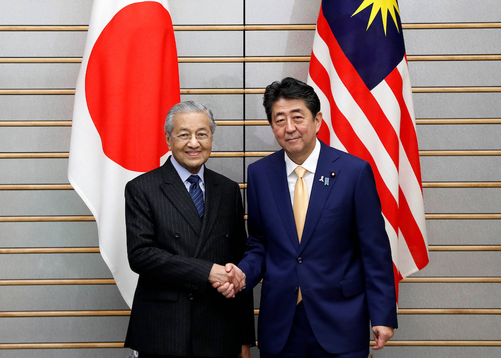 Prime Minister Tun Dr Mahathir Mohamad meets with Japan's Prime Minister Shinzo Abe at Abe's official residence in Tokyo November 6, 2018. — Reuters pic