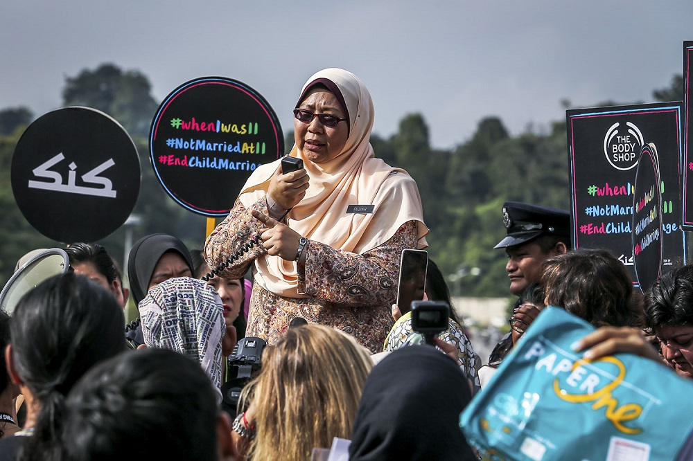 Deputy Minister in the Prime Minister's Department (Religious Affairs) Fuziah Salleh, speaks during a protest against child marriage outside the Parliament in Kuala Lumpur November 13, 2018.