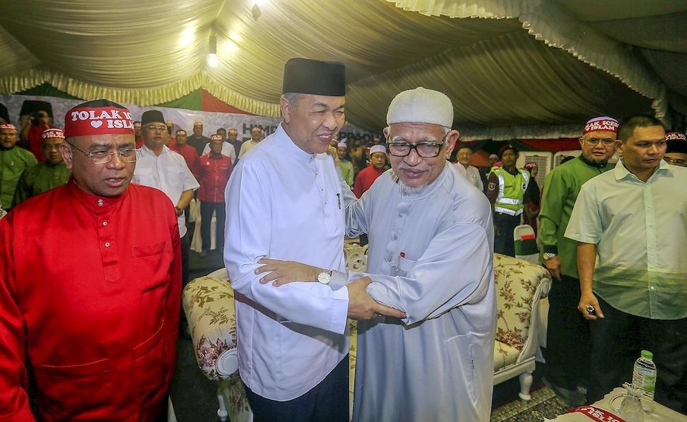 Umno President Datuk Seri Ahmad Zahid Hamidi and PAS President Datuk Seri Abdul Hadi Awang attend an ICERD protest in Kampung Gajah, Perak November 17, 2018. — Picture by Farhan Najib