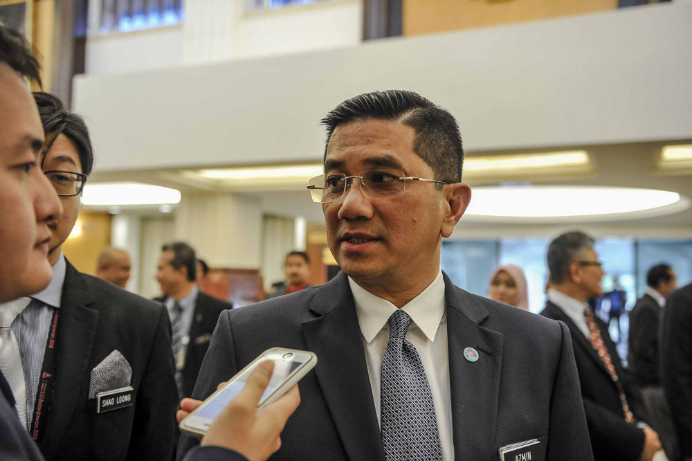 Datuk Seri Azmin Ali said the government hsa no plans to merge Felda and Felcra. — Picture by Firdaus Latif