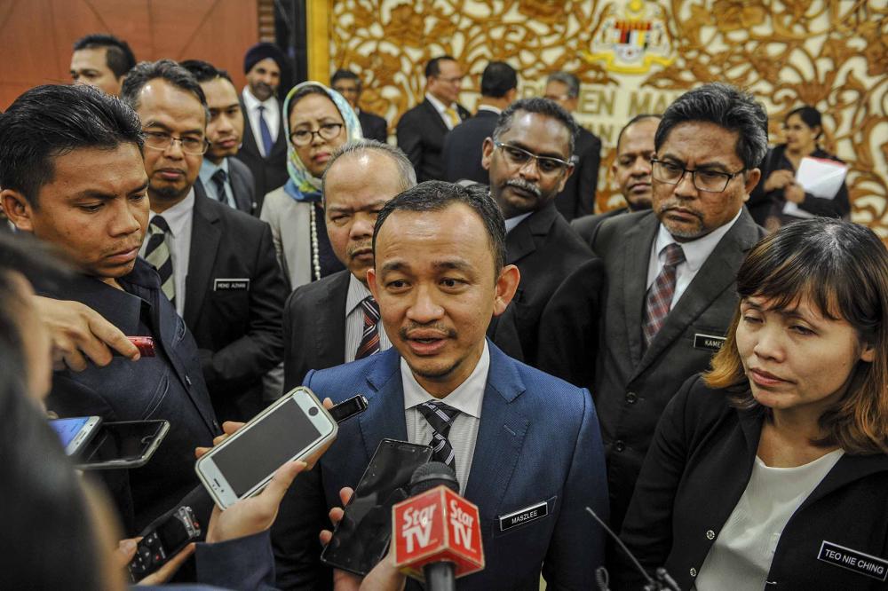Education Minister Maszlee Malik speaks to reporters at Parliament in Kuala Lumpur November 19, 2018. — Picture by Mukhriz Hazim