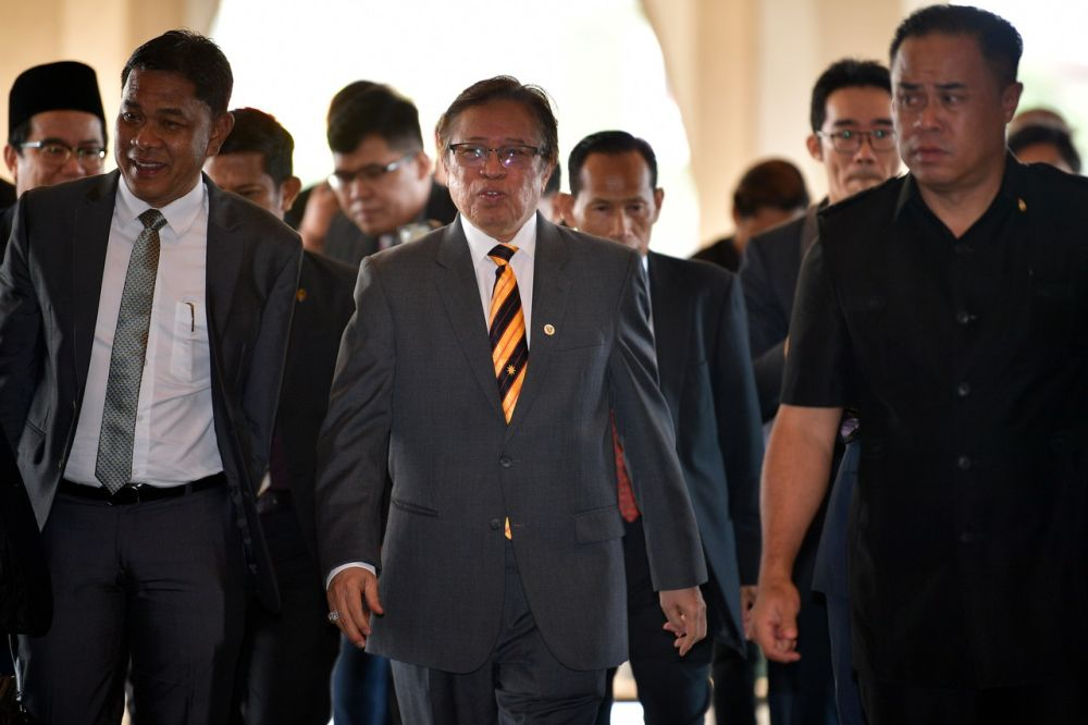 Datuk Patinggi Abang Johari Openg (centre) says the state government will place trained certified integrity officers in all state ministries to curb corruption. ― Bernama pic