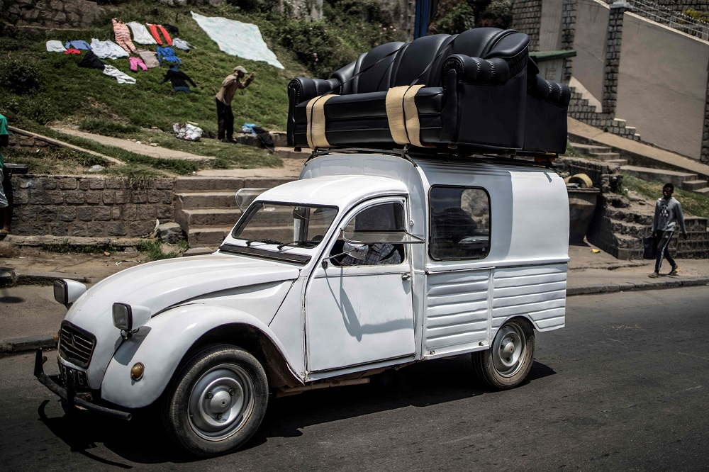 A Citroen 2CV loaded with a set of couches speeds through Antananarivo November 2, 2018. — AFP pic