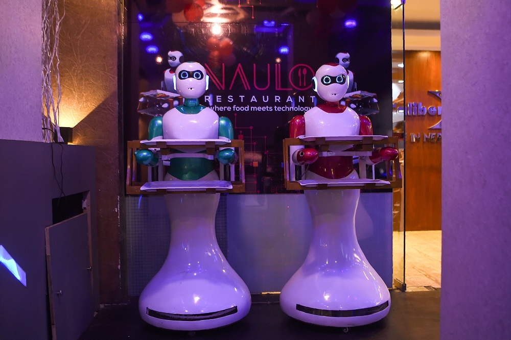 In this picture taken on October 23, 2018, Nepali-made robot waiters are pictured at Naulo restaurant in Kathmandu. — AFP pic