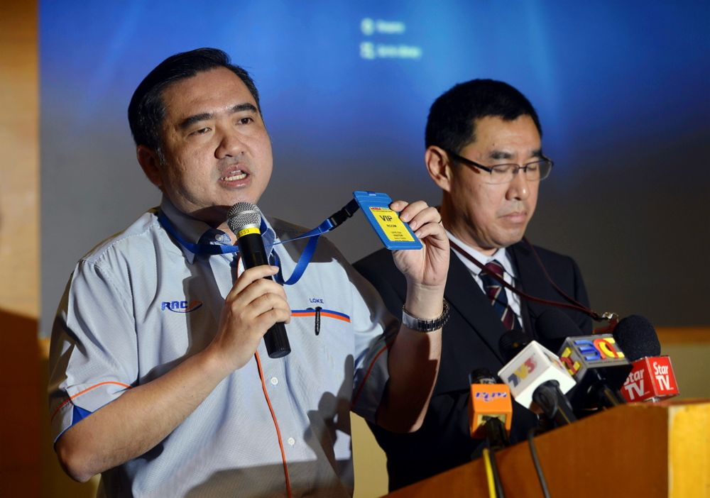 Transport Minister Anthony Loke showing the VIP security pass which every VIP accessing the special lounge must wear, after being screened at the entry. ― Picture by Ham Abu Bakar