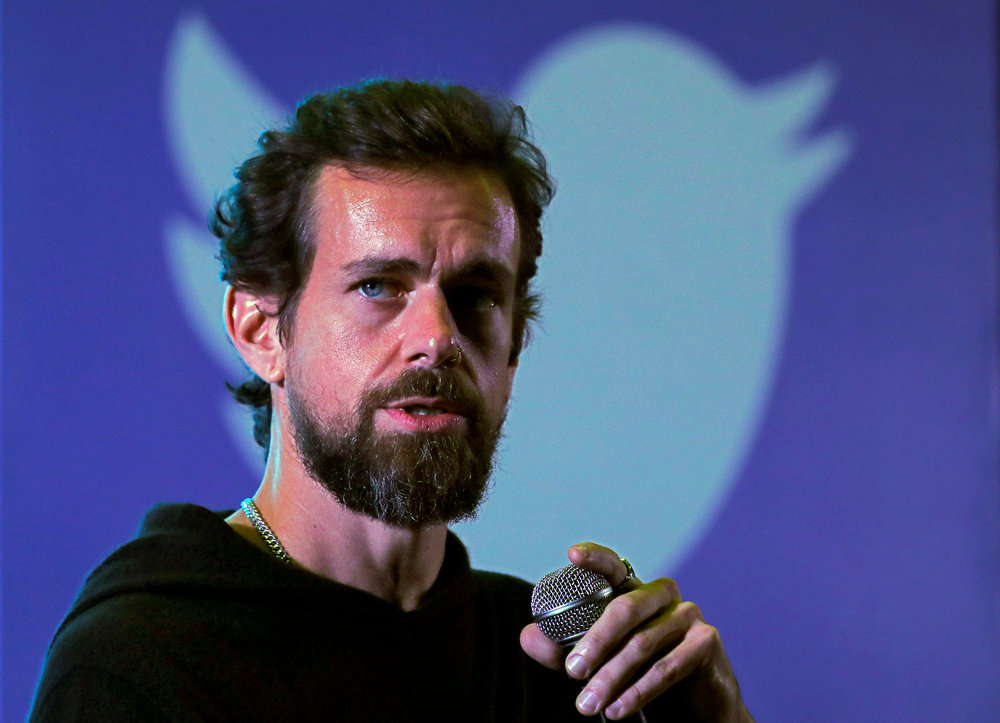 Twitter boss Jack Dorsey listed his famous post as a unique digital signature on a website for selling tweets as non-fungible tokens. — Reuters pic