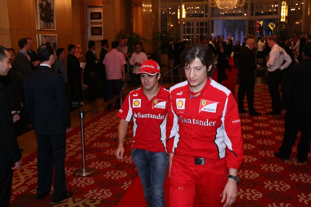 Then Ferrari driver Felipe Massa (left) arrives with a team member at the 2012 gala. — Picture courtesy of MAF