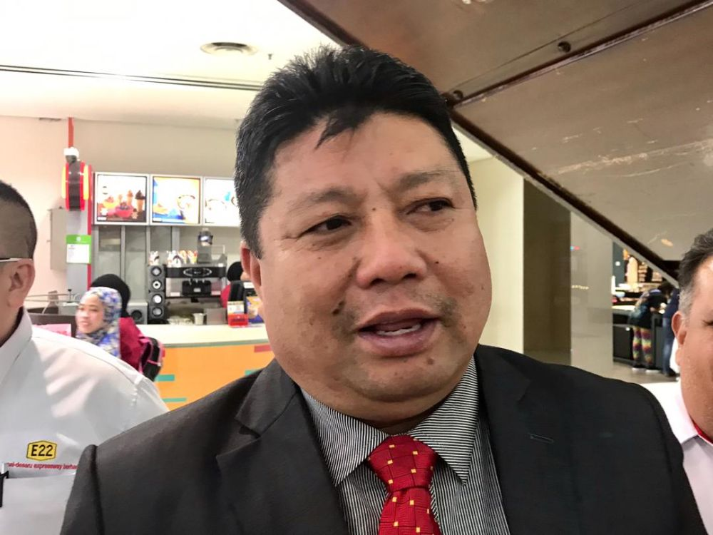 The complainant claimed to have received a telephone call from Johor Bersatu chief Mazlan Bujang (pic) ordering him to re-open the said factories.  — Picture by Ben Tan