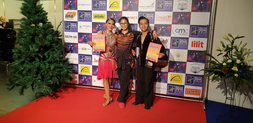 Zara Elize Ghazie Yeoh (left) and Benny Tan Yee Siang (right) with their certificates from the World DanceSport Federation at the Baltic Grand Prix Championship held in Latvia from December 14-16, 2018. ― Picture courtesy of Chua Zjen Fong/Kuala Lumpur DanceSport Association