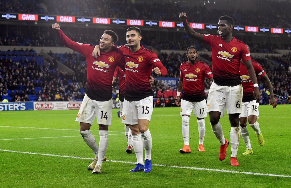 Manchester United's Jesse Lingard celebrates scoring their fifth goal with team mates during their Premier League match against Cardiff City in Cardiff December 22, 2018. — Reuters pic