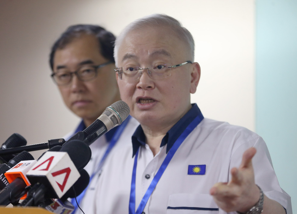 MCA president Datuk Seri Wee Ka Siong speaks to reporters after party delegates passed a resolution to dissolve BN at MCA's 65th AGM in Kuala Lumpur December 2, 2018. — Picture by Razak Ghazali