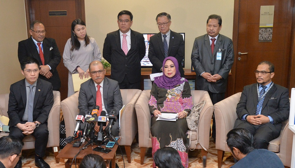 PAC chairman Datuk Seri Ronald Kiandee (seated, second left) and Auditor-General Tan Sri Madinah Mohamad (seated, second right) during a press conference in Parliament, Kuala Lumpur December 3, 2018. — Picture by Razak Ghazal