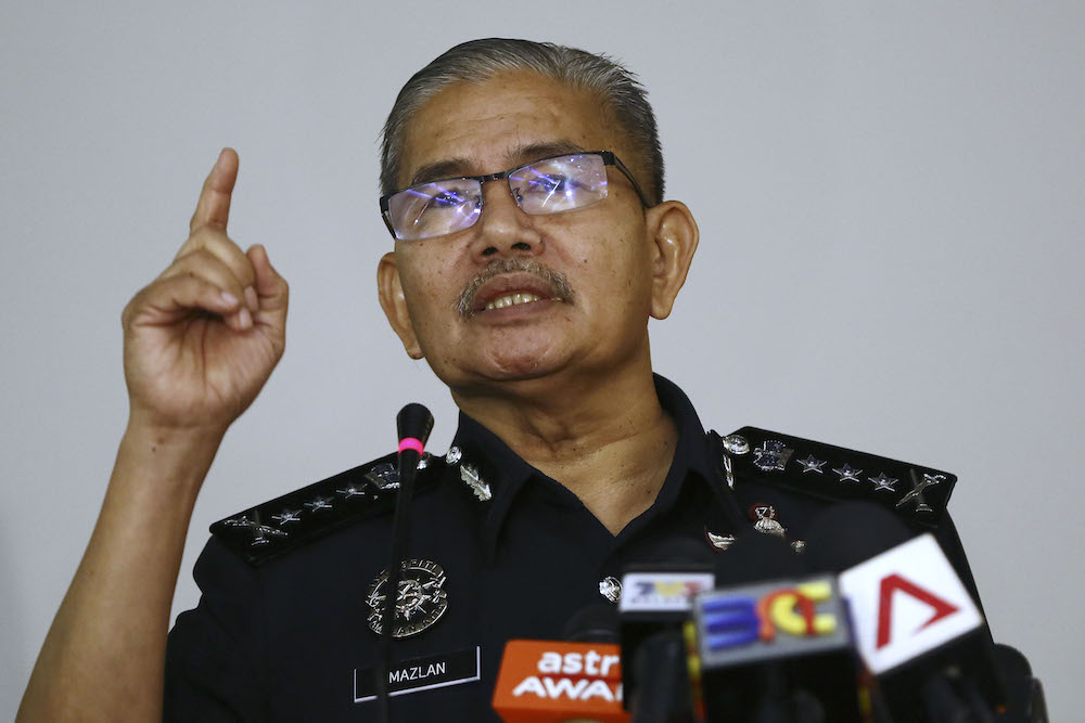 Kuala Lumpur Police Chief Datuk Seri Mazlan Lazim said a video recording of a police patrol car under attack by a group of people which supposedly occurred on Christmas day here is actually an old recording. — Picture by Yusof Mat Isa