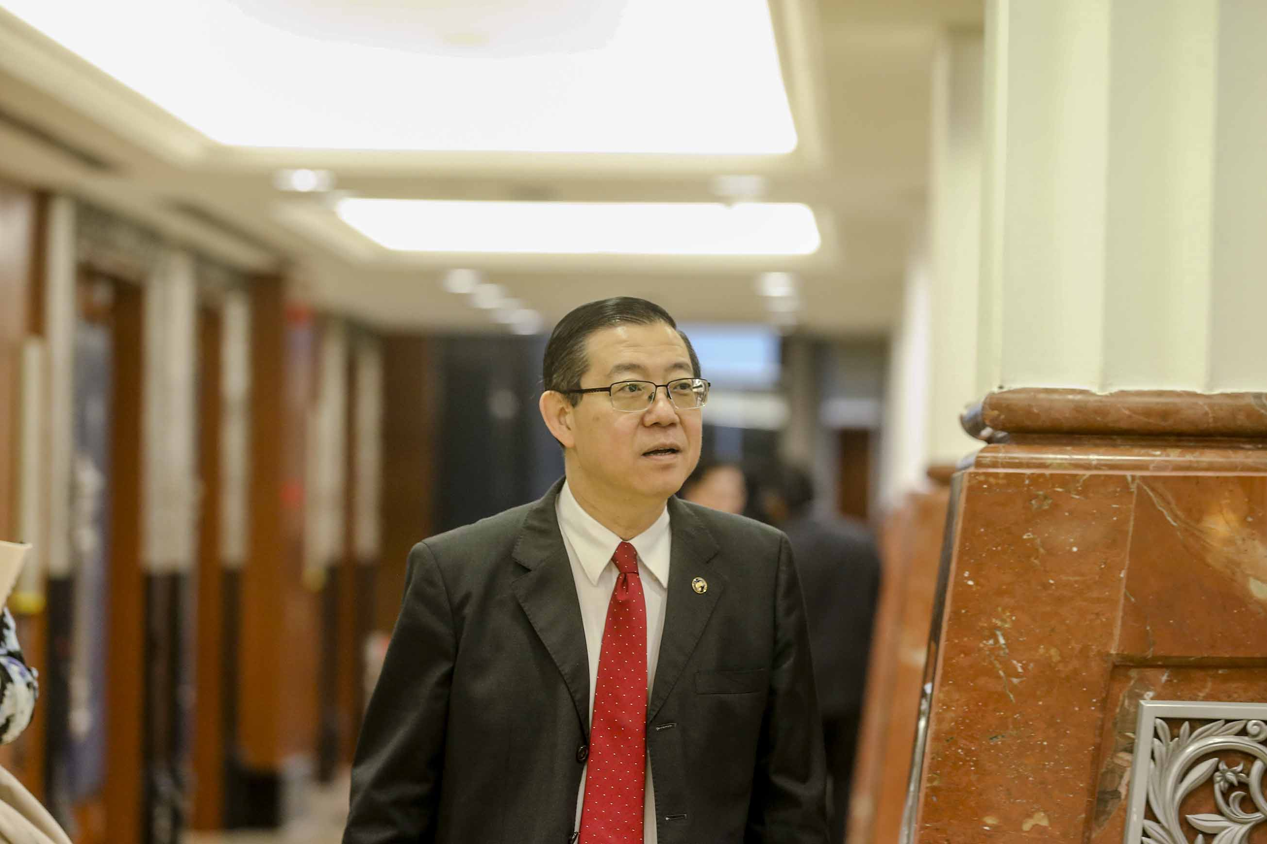Lim Guan Eng speaks to reporters in Parliament December 10, 2018. — Picture by Firdaus Latif