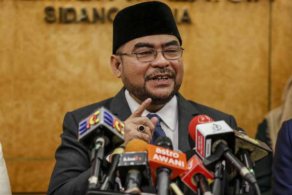 Minister in the Prime Minister's Department Datuk Seri Mujahid Yusof Rawa speaks to reporters in Parliament December 10, 2018. — Picture by Firdaus Latif
