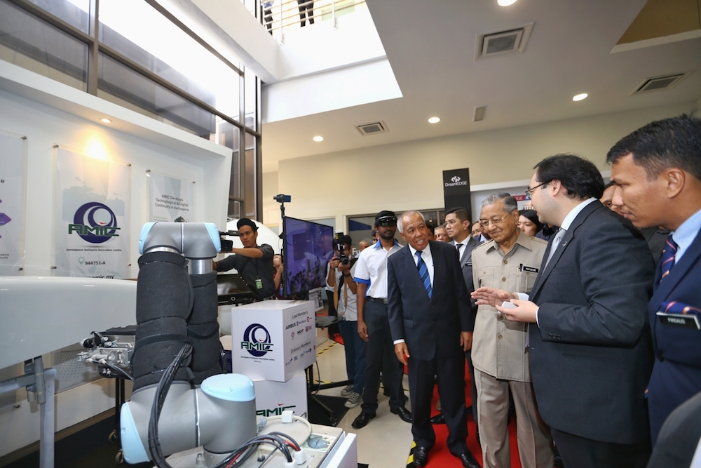 Tun Dr Mahathir Mohamad visits a booth after attending a dialogue organised by the Malaysian Industry-Government Group for High Technology (MIGHT) in Cyberjaya December 17, 2018. — Picture by Ahmad Zamzahuri