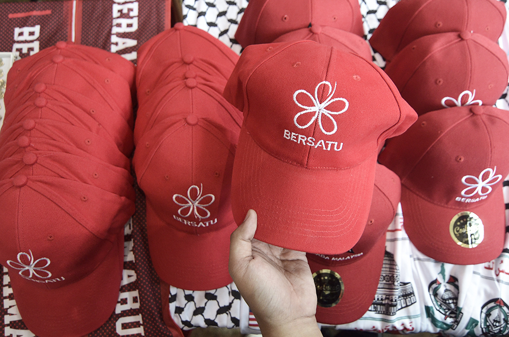 The logo of Parti Pribumi Bersatu Malaysia is seen on caps in this file picture taken December 29, 2018. — Picture by Miera Zulyana