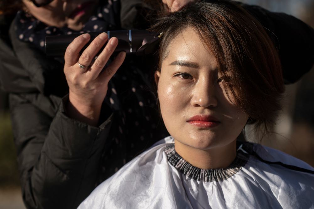 In this file photo taken December 17, 2018, Li Wenzu has her head shaved to protest the detention of her husband and Chinese human rights lawyer Wang Quanzhang, detained during the 709 crackdown, in Beijing. — AFP pic