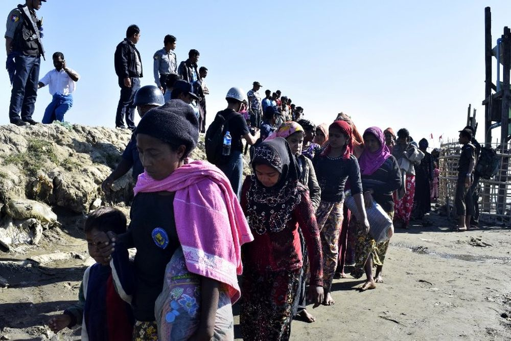 File picture shows Myanmar Navy personnel escorting a group of Rohingya Muslims back to their camp in Sittwe, Rakhine state after they were caught fleeing on a boat, November 30, 2018. — AFP pic