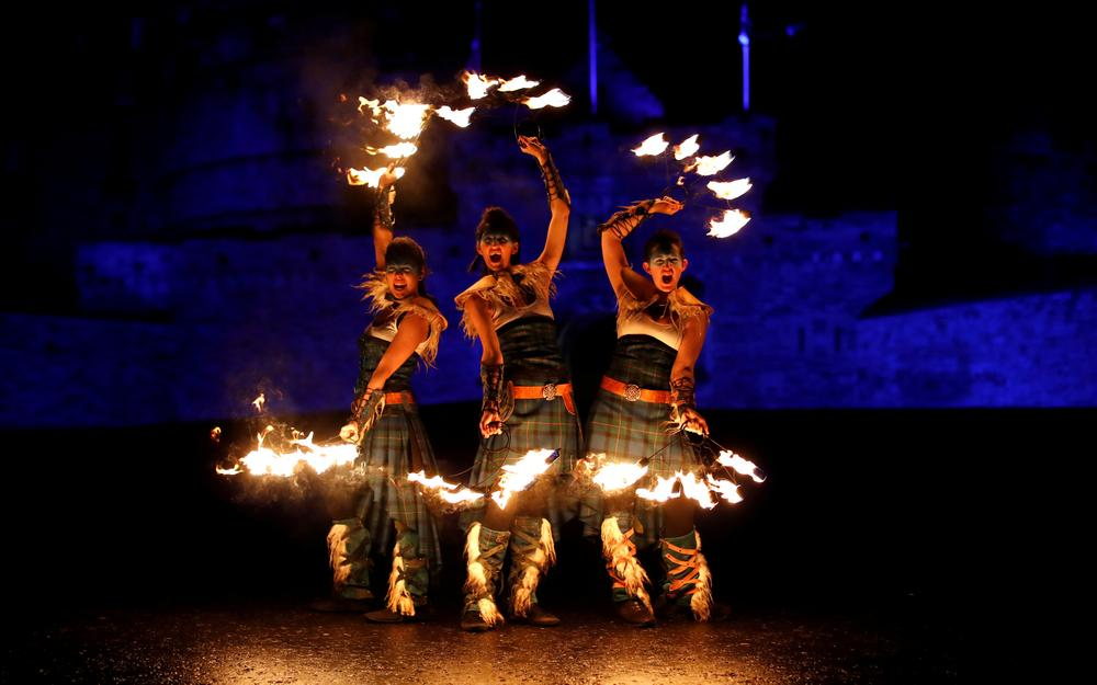 Members of PyroCeltica pose in front of Edinburgh Castle in advance of Edinburgh's Hogmanay torchlit procession down the Royal Mile in Edinburgh, Scotland December 30, 2018. — Reuters pic