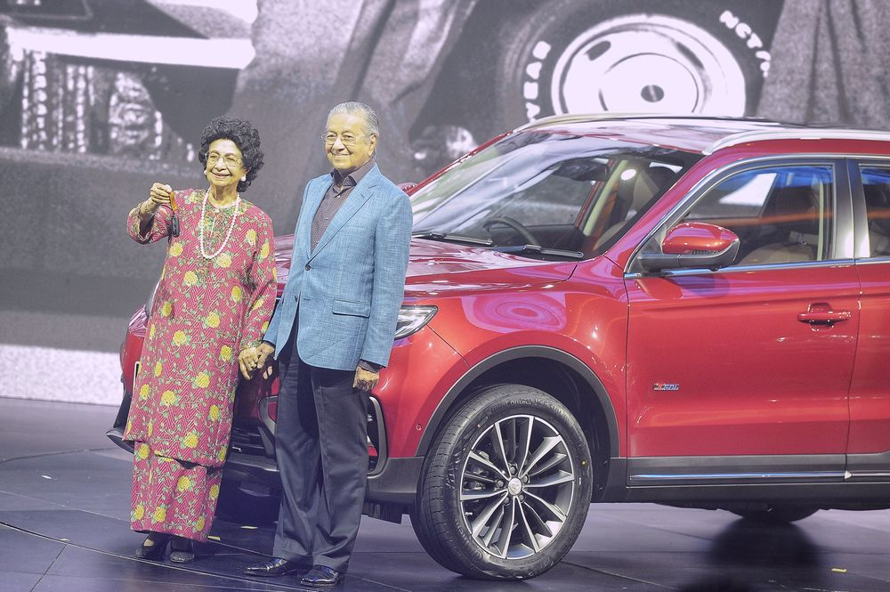 Prime Minister Tun Dr Mahathir Mohamad and his wife, Tun Dr Siti Hasmah Mohd Ali, during the official launch of the Proton X70 in the Grand Ballroom, KL Convention Centre, December 12, 2018. — Picture by Shafwan Zaidon