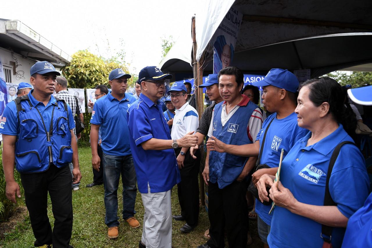 File picture shows then-Parti Bersatu Sabah deputy president Datuk Seri Maximus Ongkili greeting people as he visits the Tuaran May 4, 2018. — Bernama pic