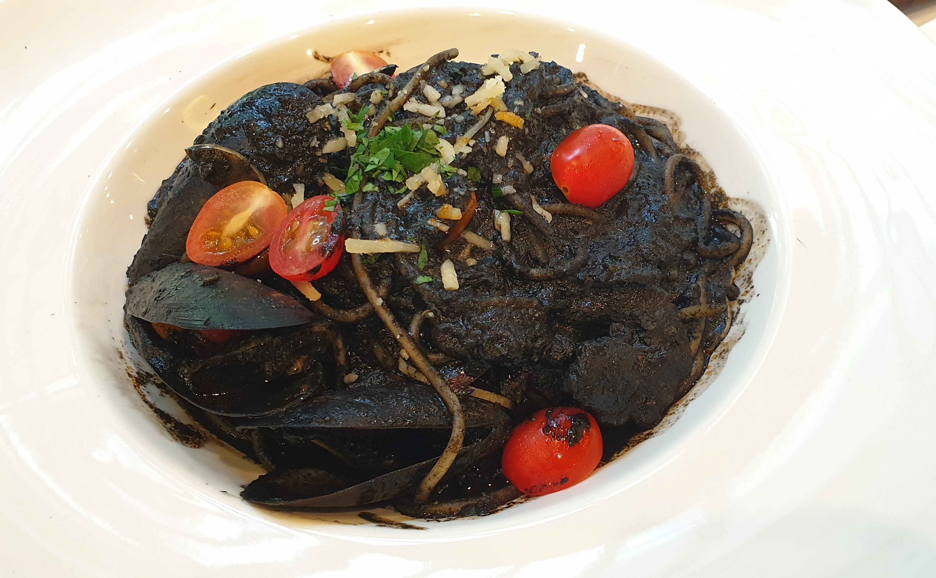 Squid Ink Spaghetti here is spicy and a treat for seafood lovers.