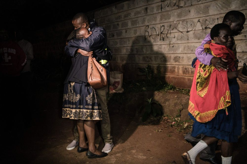 People hug after their evacuation from the DusitD2 compound in Nairobi after a blast followed by a gun battle rocked the upmarket hotel complex, January 15, 2019. — AFP pic