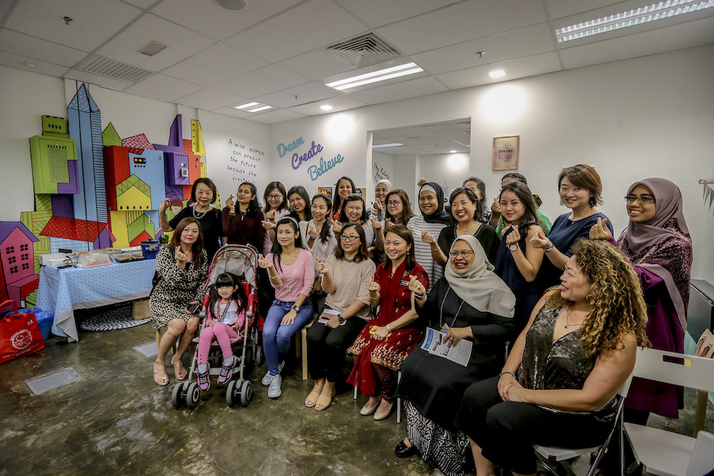 Deputy Women, Family and Community Development Minister Hannah Yeoh poses for photos during the launch of HelloHERA at Q Sentral in Kuala Lumpur January 17, 2019. — Picture by Firdaus Latif