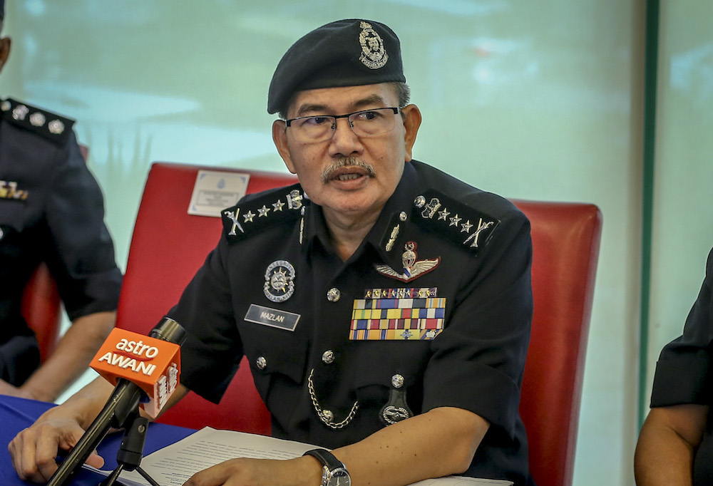 KL police chief Comm Datuk Seri Mazlan Lazim said police busted a drug distribution syndicate following the arrests of five individuals in several locations throughout the city centre last week. — Picture by Firdaus Latif