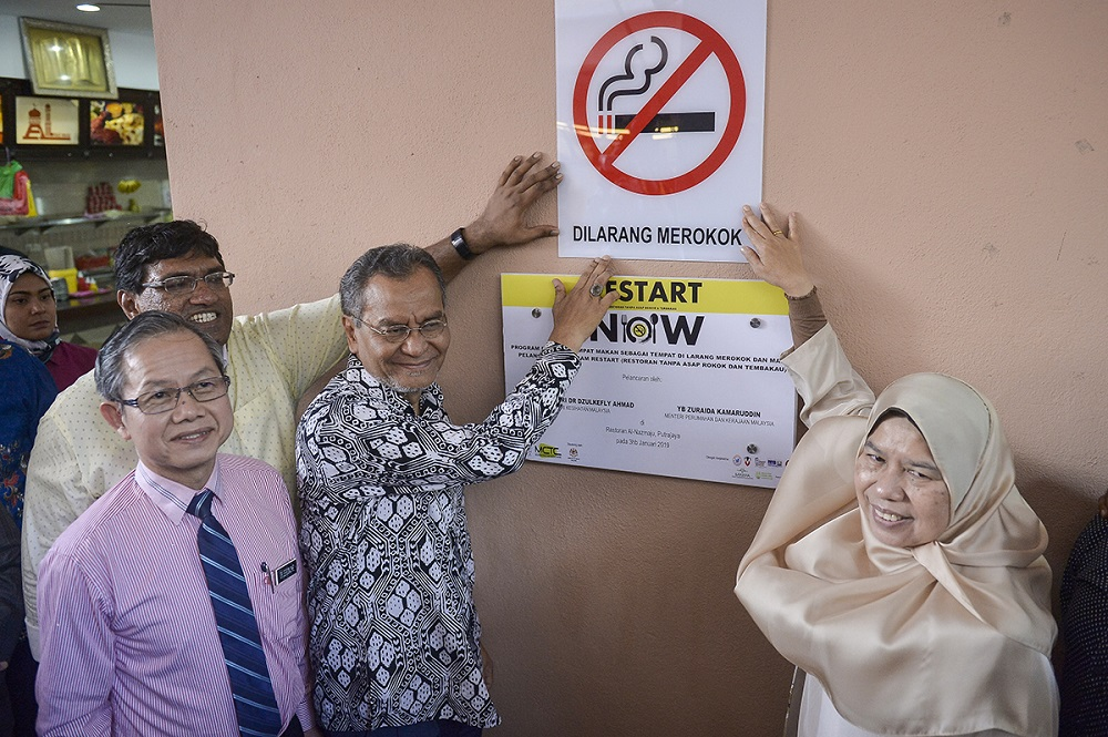 Health Minister Datuk Seri Dzulkefly Ahmad (third left) and Housing and Local Government Minister Zuraida Kamaruddin (right) during the launch of an anti-smoking campaign in Putrajaya January 3, 2019. — Picture by Mukhriz Hazim