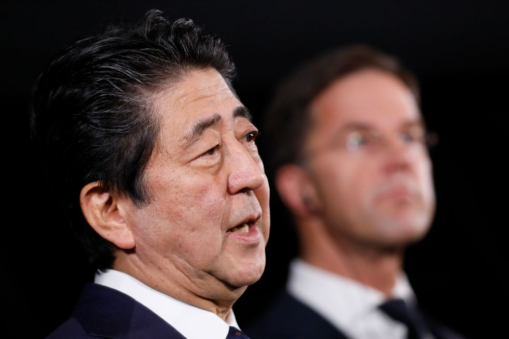 Japanese Prime Minister Shinzo Abe and Dutch Prime Minister Mark Rutte give a press conference January 9, 2019, in Rotterdam, during Abe's visit to the Netherlands. — Bas Czerwinski/ANP pic via AFP