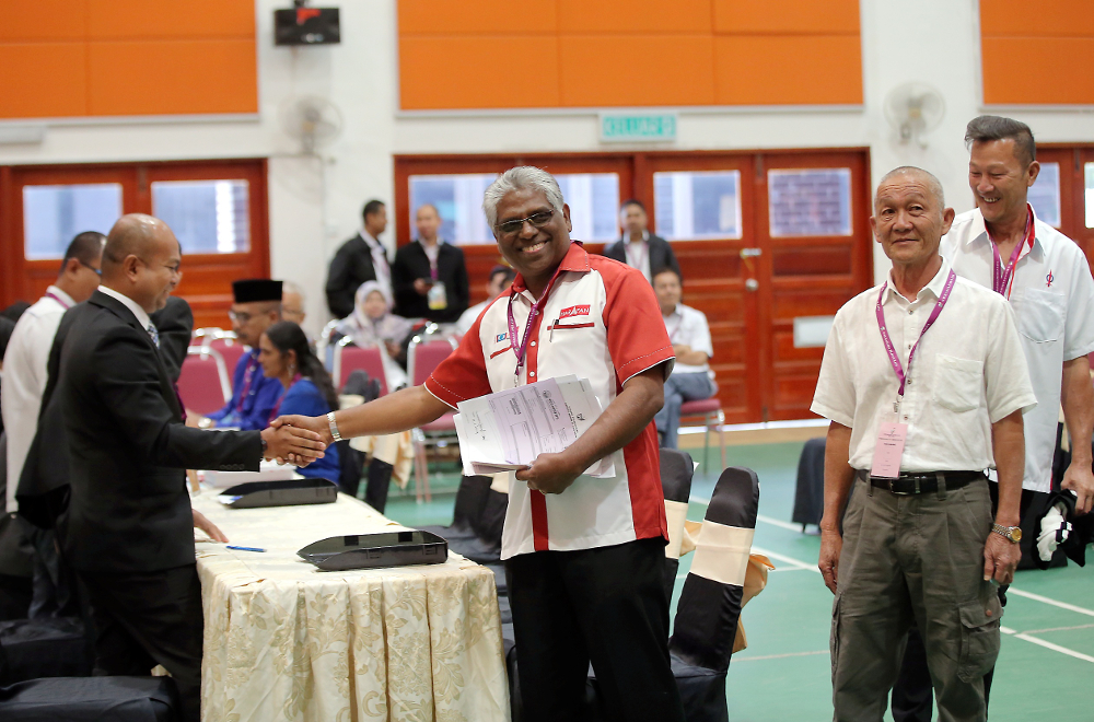 PH candidate M. Manogaran files his nomination form for the Cameron Highlands parliamentary by-election at the nomination centre in Perak January 12, 2019. — Picture by Farhan Najib