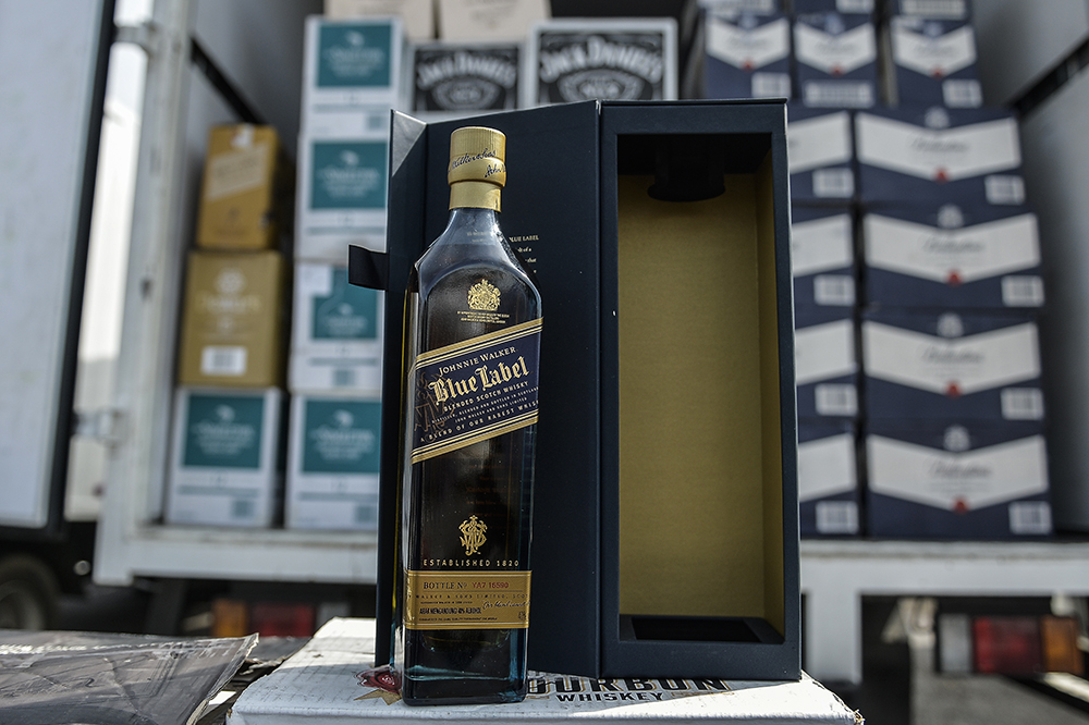 The General Operations Force seized smuggled liquor and cigarettes worth RM1.8 million in several raids. — File picture by Miera Zulyana